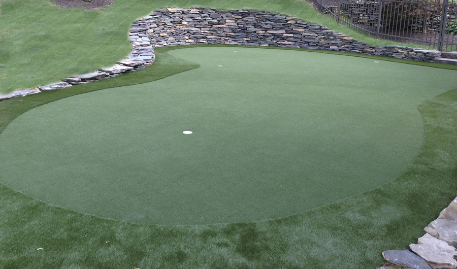 Large artificial turf lawn with putting green in Bethlehem