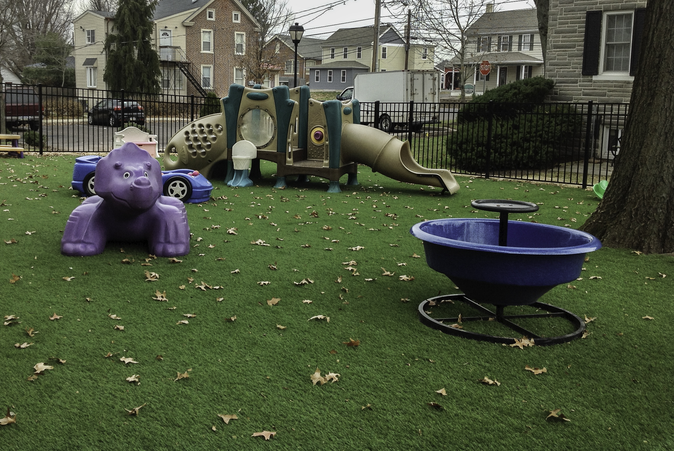 Enclosed Philadelphia day care play area with artificial turf surface