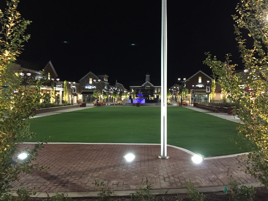 Alternative view of the outdoor mall courtyard turf install at night
