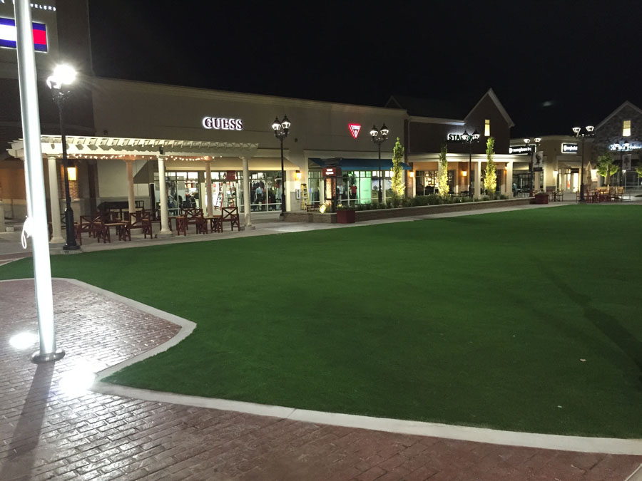 Close-up view of pavers and artificial turf at outdoor mall courtyard