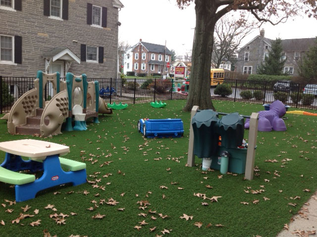 Childrens play area on artificial playground grass in New Jersey