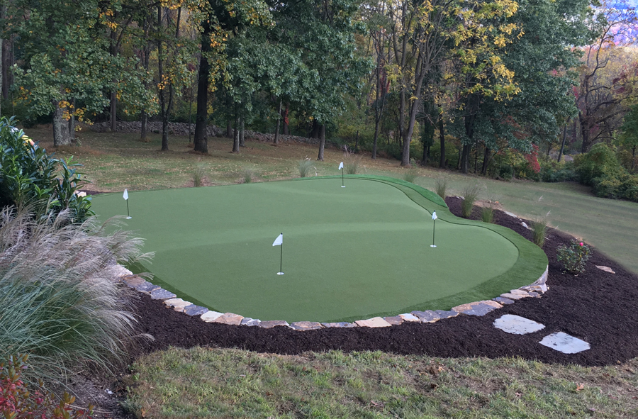 Landscaped personal artificial turf putting green in New Jersey