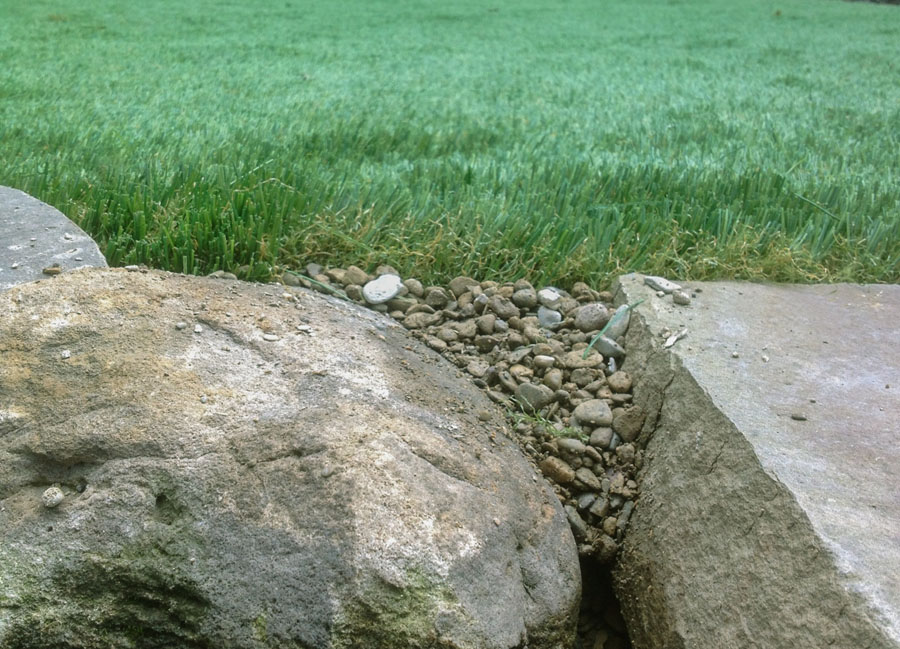 Close up of the edge of an artificial grass lawn