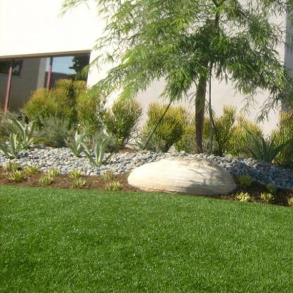 Rock garden surrounding artificial lawn in New Jersey