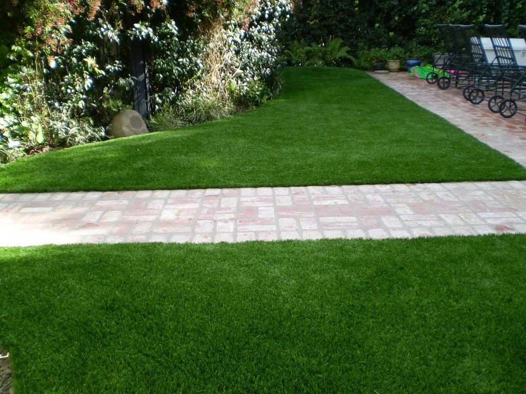 Synthetic grass lawn surrounds a brick pathway at a Philadelphia home